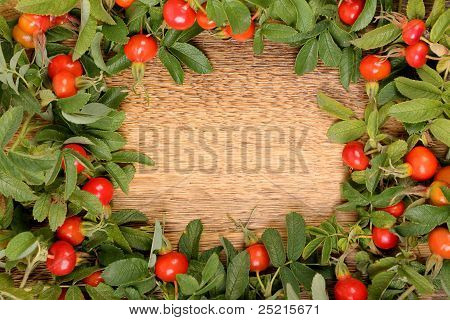 Dogrose on a wooden surface