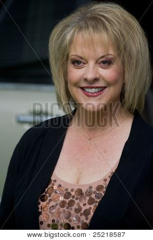 "HOLLYWOOD, CA - NOVEMBER 12: Nancy Grace arrives at the Los Angeles premiere of ""The Muppets"" held at the El Capitan Theater on November 12, 2011 in Hollywood, CA"
