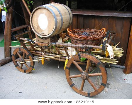 Old Wooden Cart With Wooden Barrel And Grapes