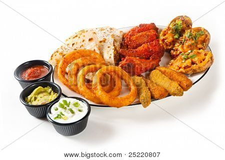 Appetizer plate with dipping sauces on white