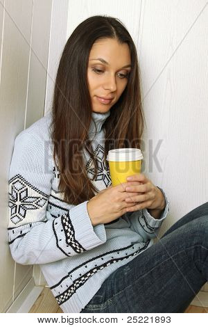 Woman with a glass of coffee