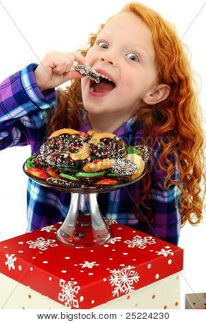 Beautiful Excited Girl Child In Pajamas With A Tray Of Holiday Cookies