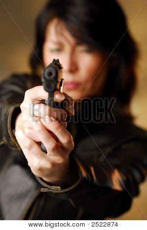 Woman Firing From A Gun