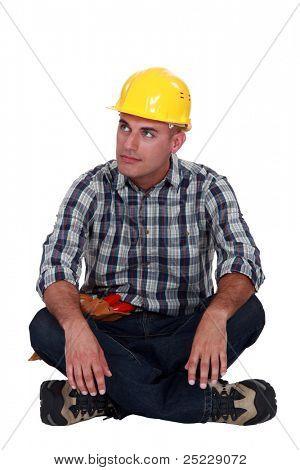 A pensive construction worker.
