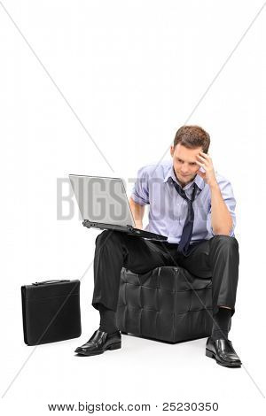 A disappointed businessman and his laptop isolated on white background