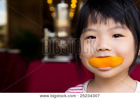 Cute Girl Eating Orange