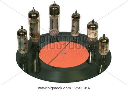 Radio Tubes Standing On The Vinyl Disc
