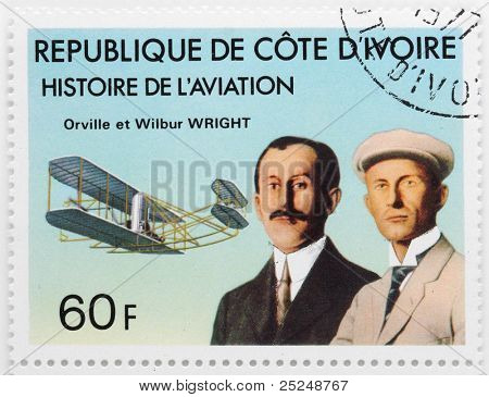 IVORY COAST - CIRCA 1977: A stamp printed in The Ivory Coast shows The Wright brothers were building the world's first successful airplane and making the first  human flight, circa 1977.