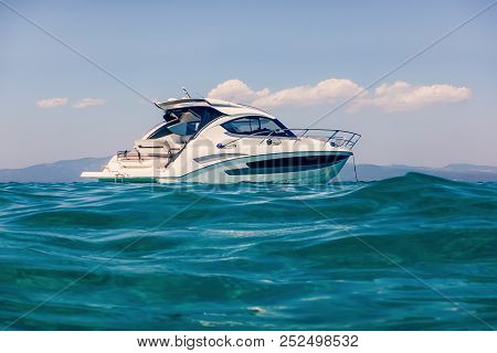 Motor Boat Floating On Clear