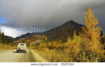Car On Road, Dempster Highway, Yukon Territory, Canada
