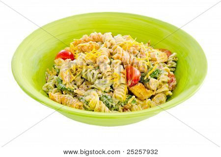 Cheesy bacon, lettuce and tomato pasta salad in green bowl isolated on white