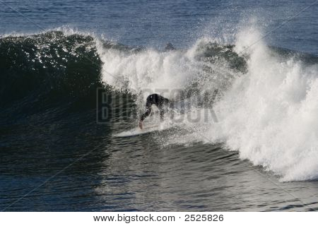 A Surfer Riding The Giant Waves