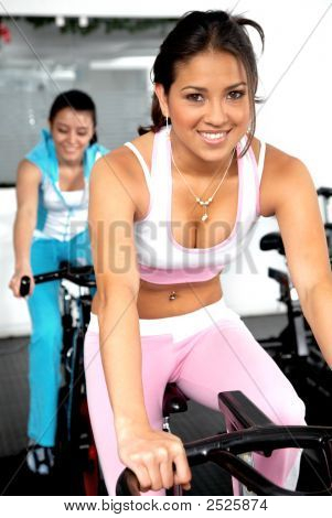 Girls Cycling At The Gym