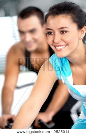 Girl Cycling In A Gym