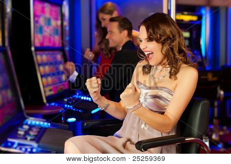 Friends in Casino on a slot machine; all obviously are winning