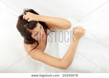 Young beautiful caucasian woman in bed abused