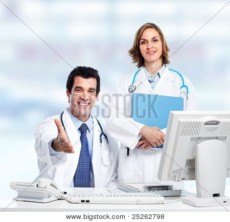 Group of medical doctors. Over blue background. Health care.