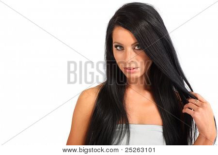 beautiful brunette woman with flowing hair looks mysteriously isolated on white