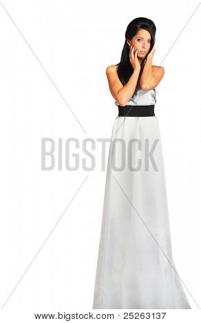 beautiful girl wearing long silver dress looks enigmatic isolated on white background