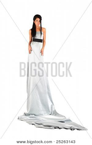 beautiful girl wearing long silver dress looks mysteriously isolated on white background