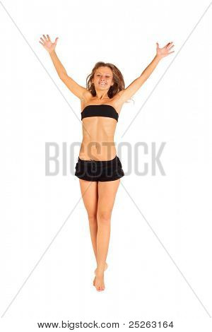 happy girl gracefully jumping up with raised arms isolated on white background