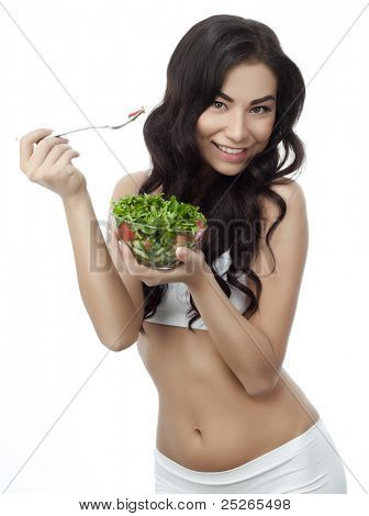 portrait of attractive  asian smiling woman isolated on white studio shot eating salad