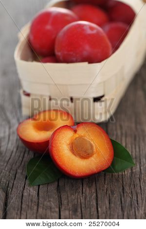 Fresh Red Plums On Wooden Background