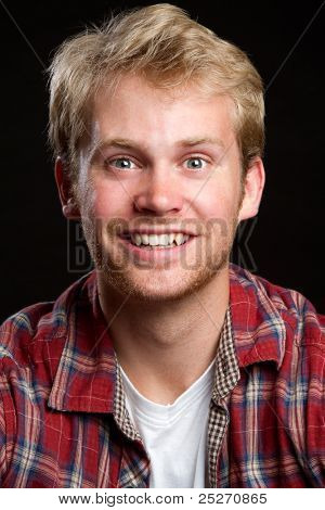 Happy cheerful young man smiling