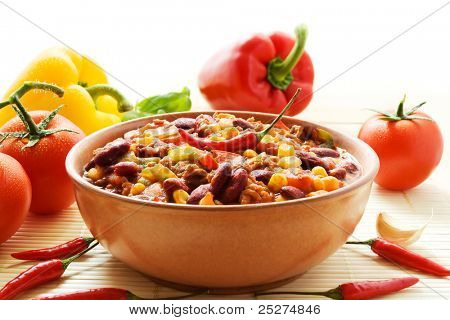 Bowl of chili con carne with ingredients