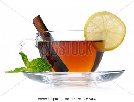 Cup of tea with lemon, cinnamon and mint