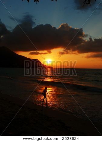 Woman Walking On The Beach At Sunset, Seychelles