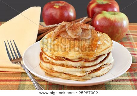 Stacked Pancakes With Baked Apples Topping.