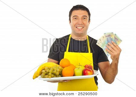 Happy Greengrocer Holding Money