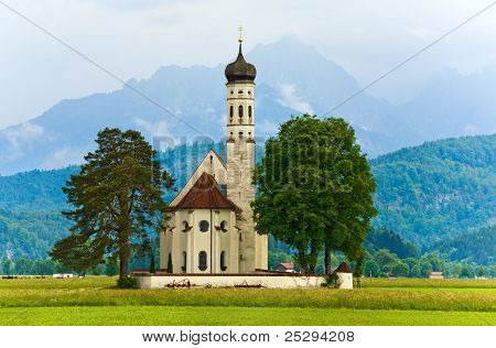 Neuschwanstein Castle In Germany And Church Near