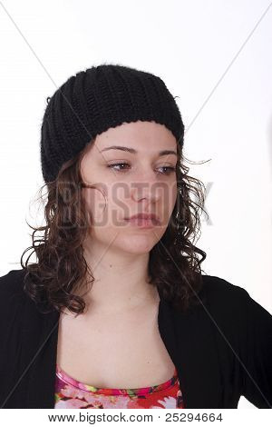 Younge Brunette In Knit Cap Looking Down To Left Serious