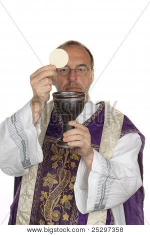 catholic priest during communion