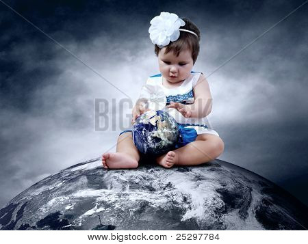 Child sitting on the Planet Earth with globes in hands
