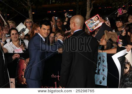 "LOS ANGELES - NOV 14:  Taylor Lautner signing autographs  at the ""Twilight: Breaking Dawn Part 1"" World Premiere at Nokia Theater at LA LIve on November 14, 2011 in Los Angeles, CA"