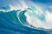 MAUI, HI - MARCH 13: Professional surfer Marcio Freire rides a giant wave at the legendary big wave