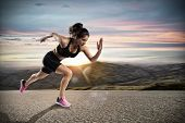 Athletic Woman Runs On The Street During Sunset poster