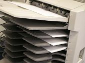 stock photo of collate  - a copy machine with copies in tray - JPG
