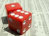 pic of stock market crash  - red dice showing seven on stock market section of newspaper - JPG