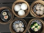 Steamed Stuffed Cream Bun, Chinese Steamed Dumpling With Shrimp And Chinese Ha-kao In Bamboo Basket  poster