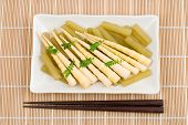 stock photo of butterbur  - Bamboo shoots and butterbur stalk boiled in stock - JPG