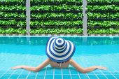 Young Asian Woman Relaxing In Swimming Pool At Spa Resort. Relaxing Concept. Beautiful Young Woman I poster