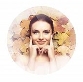 Beautiful Face Of Young, Natural And Healthy Woman Over Fallen Leaves. Healthcare, Spa, Makeup And F poster