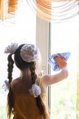 A Girl Carrying Out Home Inspections, Washes Dirty Windows With A Rag And Window Cleaner. Focus On H poster