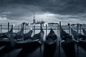 Gondola park in water and San Giorgio Maggiore island in Venice in an overcast day, Italy. poster