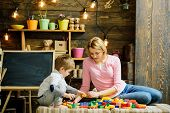 Mothers Day Concept. Mother And Little Son Play With Toy Bricks On Mothers Day. Mothers Day Games. H poster
