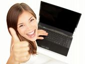 stock photo of cheer-up  - Laptop woman happy giving thumbs up success sign sitting at computer PC with excited face expression - JPG